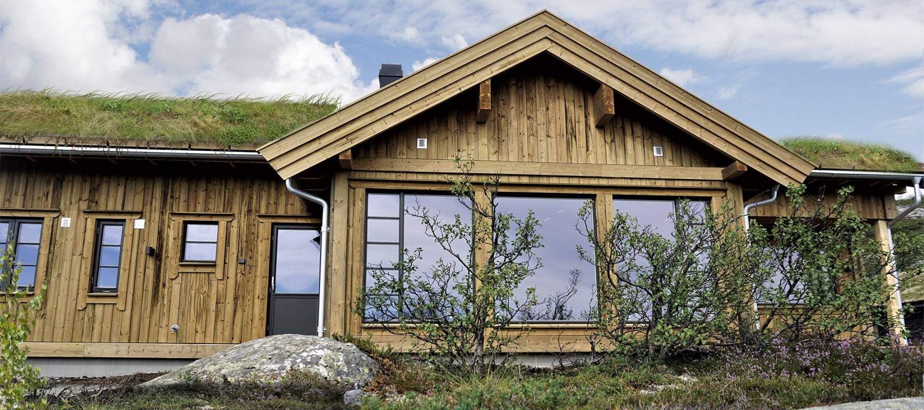 22 Hyttemodell Høgevarde 127. Soverom, bad og badstue med vindu mot utsikten