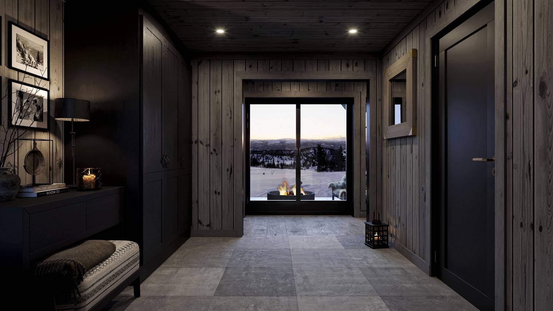100 Velkomst til hytta med stemningsfulle bålflammer og vinterlandskap i front – Hyttemodell Geilo 155